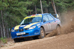 Rally Subaru Impreza. Driver Wug Utting kicking up dust in a Subaru Impreza on the Warren stage of the MSA Tempest 4 Rally in Bramshill Forest, UK on November 3 Stock Photography