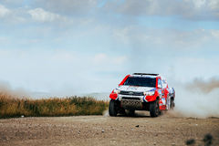 Rally Toyota car rides on dusty road Royalty Free Stock Photo