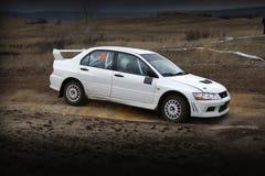 Powerslide. Rallycar Mitsubishi EVO sliding in a corner - all logos, markings removed stock photo