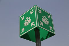 Rallying point. Green sign with regard to a meeting point in front of blue sky Stock Images