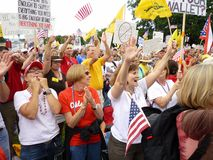Rallying to the Cause. Photo of protesters giving their support at the capitol in washington dc on 9/12/09. These people are part of the tea party tax protest royalty free stock image