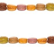 Ram av kulöra franska macarons för pastell Arkivfoto