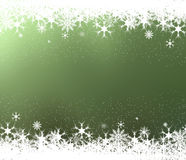 Ram av snöflingor på grön bakgrund Arkivbild