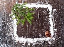 Ram av snön med jul Arkivbilder