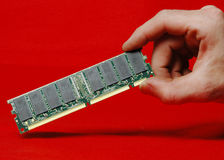 Ram dimm in hand. Hand holding a ram random access memory card for an upgrade to a computer Stock Image
