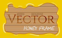 Ram för droppar för honungsirap flödande på träbakgrund Royaltyfri Fotografi