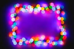 Ram för ljus för julbokeh flerfärgad royaltyfri foto