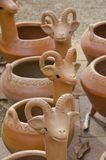 Ram Flower Pot Containers. Several empty flower pot containers created in the shape of rams or sheep with horns are displayed together Stock Photo
