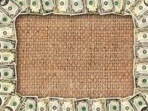 Ram från dollar på bakgrunden av att plundra Arkivfoto