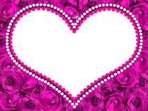 Ram i form av hjärta från violetta rosor fotografering för bildbyråer