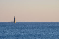Ram Island Ledge Lighthouse at Sunrise at the North Entrance to Royalty Free Stock Photo