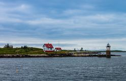 Ram Island lighthouse on a cool and foggy day. Ram Island lighthouse seen from Ocean Point, Maine on a cool and foggy day royalty free stock images