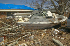 Ram Jam boat and debris in front of house heavily hit by Hurricane Ivan in Pensacola Florida Royalty Free Stock Image
