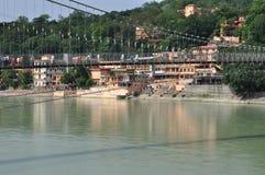 Ram Julla, Rishikesh, India. The river Ganges. Indian Himalaya: the hindu holy river Ganges by Rishikesh, Uttarkhand, India. The hanging bridge of Ram Julla royalty free stock photography