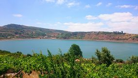 Ram Pool near the Druze Village of Mas'ade. View of the Lake Ram or Ram Pool, a crater lake in the northeastern Golan Heights, near Mount Hermon and the Druze stock image