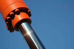Ram and Sky. A close up of a hydraulic ram with lots of room for copy in a blue sky stock photos