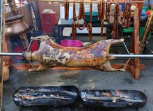 Ram on a spit. Grilled outlaw and sheep sausage in the background Stock Images