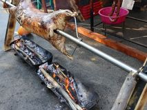 Ram on a spit. Ram robber cooking fire on a spit
