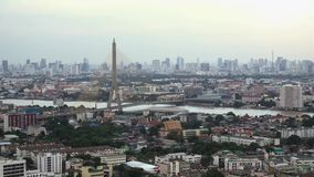 Rama 8 bridge and skyscrapers in Bangkok City, Thailand.  stock footage
