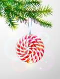 Rama de árbol de navidad con el caramelo redondo Imágenes de archivo libres de regalías