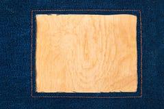 Rama dla teksta od ciemnej cajg tkaniny z zaszytymi liniami pomarańczowa nić zdjęcie stock