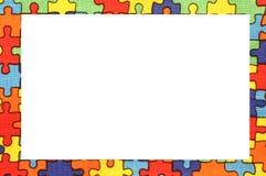 Rama kolorowi łamigłówka kawałki na bawełnie farbował tkaninę Zdjęcia Stock