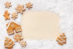 Rama piernikowi ciastka i śnieg z kopii przestrzenią ilustracji