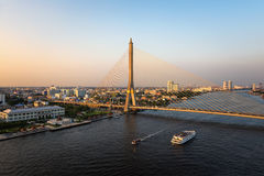The Rama VIII Bridge is a cable stayed bridge crossing the Chao Phraya River Stock Photos