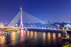Rama VIII Bridge at night in Bangkok and Chopraya river, Thailan Stock Photo
