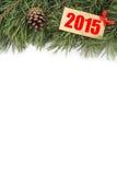 Rama y topetones de árbol de navidad con la placa de madera con el texto 2015 Fotografía de archivo libre de regalías