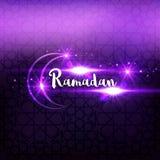 Ramadan arabic islamic lettering dark glowing background. Arabian greeting festive card.  Royalty Free Stock Photo