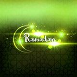 Ramadan arabic islamic lettering dark glowing background. Arabian greeting festive card.  Stock Image