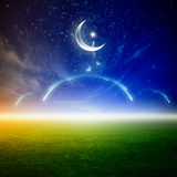 Ramadan background. With moon and stars, abstract mosque above green field, islamic holy month