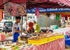 Ramadan Bazaar Kuala Lumpur. Kuala Lumpur,Malaysia - July 13, 2014: The hawkers preparing the foods in Ramadan Bazaar.It is established for Muslim to break fast Royalty Free Stock Photo