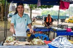 Ramadan Bazaar Kuala Lumpur. Kuala Lumpur,Malaysia - July 23, 2014: The hawkers preparing the grilled lamb in Ramadan Bazaar.It is established for Muslim to Royalty Free Stock Image