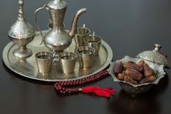 Ramadan concept: Dates, zam zam water and rosary on brown table royalty free stock images