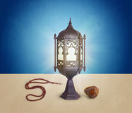 Ramadan Concept of Lamp, Rosary and date. Served after Fasting
