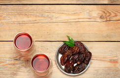 Ramadan dates. Still life, food and drink, holidays concept. Ramadan dates and tea on a wooden table. Selective focus, copy space background, top view