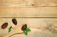 Ramadan dates. Still life, food and drink, holidays concept. Ramadan dates on a wooden table. Selective focus, copy space background, top view