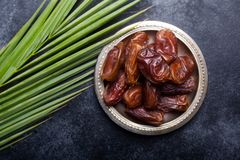 Ramadan dates is traditional food for iftar in islamic world. Dark background royalty free stock images