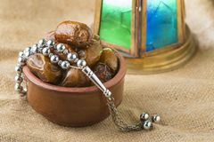Ramadan Dried Dates with Lantern and Rosary. On Vintage Background royalty free stock photos