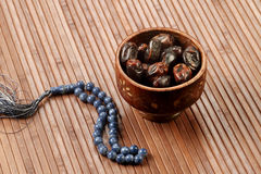 Ramadan Fresh dates in a wooden bowl with rosary Stock Photo