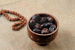 Ramadan fresh dates in a wooden bowl with rosary Royalty Free Stock Photography