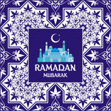 Ramadan greeting blue. Ramadan greeting card with the image of the mosque, minarets and Middle East pattern in Moorish style. Vector template Stock Photo