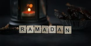 Ramadan Greeting Scrabble Letters. Ramadan Candle Lantern with W. Ooden Prayer Beads and Dates Royalty Free Stock Photos