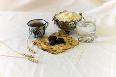 Ramadan Iftar break fast. Iftar  black dates and bread and water for breaking fast Stock Image