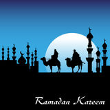 Ramadan Kareem. Background with two men riding camels near a city with minarets. Ramadan Kareem postcard concept