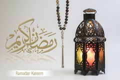Ramadan Kareem, Greeting card for Holy month of Muslims. Ramadan Kareem, Arabic Calligraphy, Translation : Ask God to let us reach the fasting month Ramadan royalty free stock images