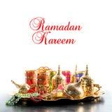 Ramadan kareem Arabic tea coffee rosarygolden decoration. Ramadan kareem. Arabic tea coffee table with rosary and golden decoration Royalty Free Stock Photos