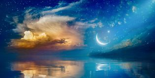 Ramadan Kareem background with crescent, stars and glowing cloud stock images